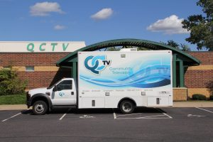 Truck and QCTV building